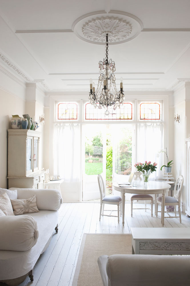 French country living space with chandelier